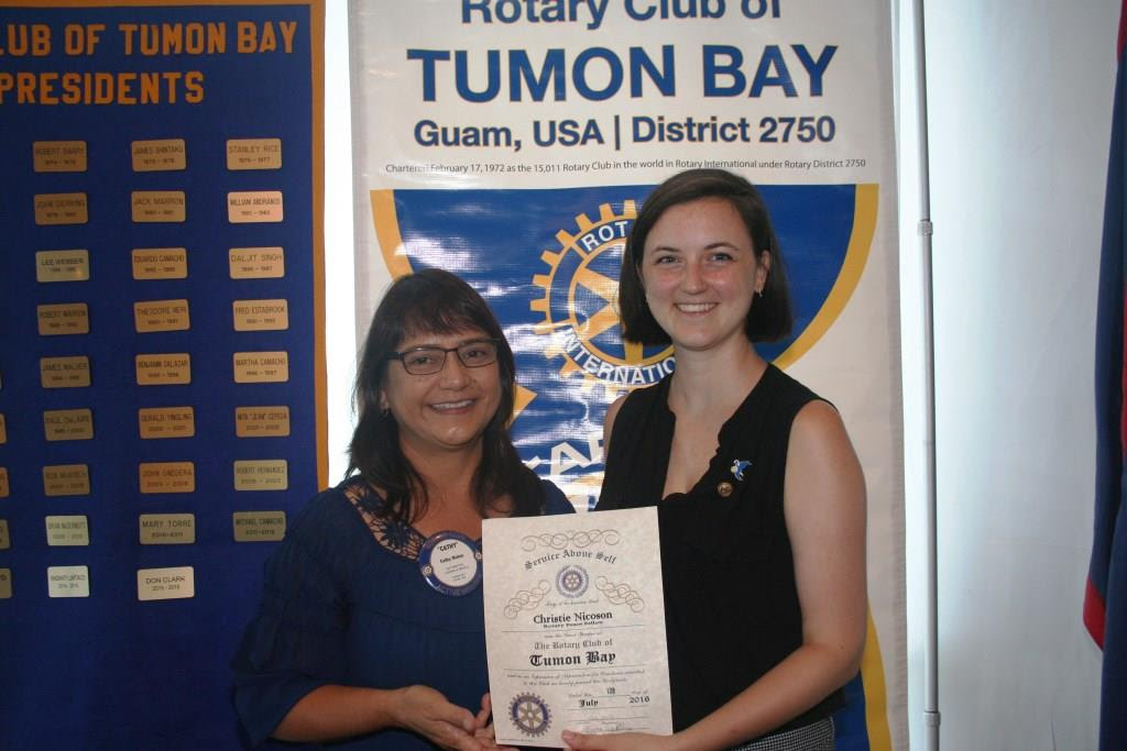 9.Rotary Club of Tumon Bay: Christie Nicoson and President of the Rotary Club of Tumon Bay, at a talk about Christie's research on Food Security of Positive Peace in Guam.